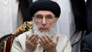 Afghan warlord Gulbuddin Hekmatyar prays before giving a speech to supporters in Jalalabad, Afghanistan, on 30 April 2017