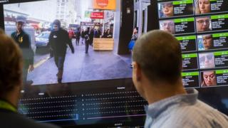 A display shows a facial recognition system for law enforcement during the NVIDIA GPU Technology Conference