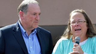 Rowan County Clerk Kim Davis, with Republican presidential candidate Mike Huckabee, left, at her side, speaks after being released from the Carter County Detention Center, Tuesday, Sept. 8, 2015, in Grayson, Ky.