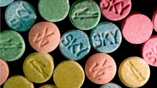 Multi-coloured ecstasy pills marked with various logos. Street slang/terms for ecstasy