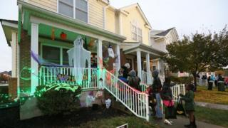 kids trick or treating at house