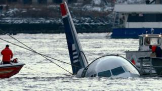 US Airways plane being rescued from the Hudson River.