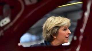 Theresa May seen through car door