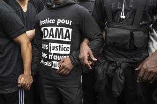 Protesters lock arms during an antiracism protest on June 13, 2020 in Paris, France. The anti-racism protests here that began with expressions of solidarity with George Floyd, the American man who was killed by police in Minneapolis, have also highlighted the case of Adama Traore, a 24-year-old French Malian man who died in police custody in 2016.