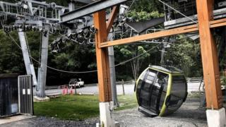 A cable car sits on the ground on a slack rope in this police handout