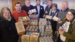 Volunteers with food donations