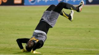 "Ivory Coast""s Asec Mimosas goalkeeper Yao Kouassi celebrates after scoring against Egyptian team Al Ahly during his CAF Champions League group B stage football match at the Borg el-Arab Stadium in Alexandria on June 28, 2016"