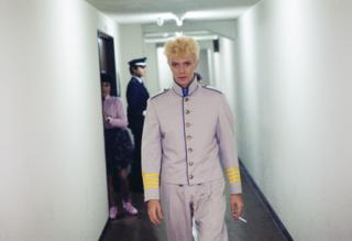 David Bowie backstage in Japan, heading towards the stage.