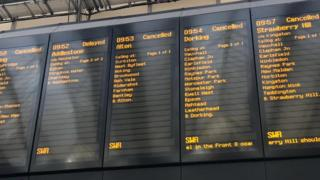Departure boards showing delayed or cancelled messages
