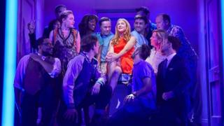Company cast on stage