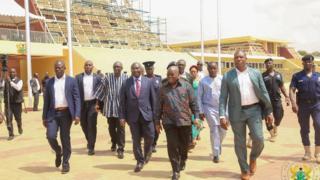 President Akufo-Addo dey walk for Flagstaff House now Jubilee House plus some of en Ministers den staffers