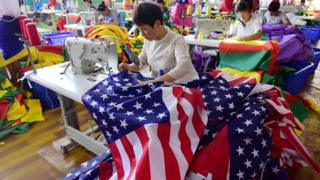 Chinese employees sew US flags at a factory in Fuyang