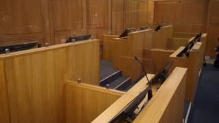 An example of the socially-distanced court room
