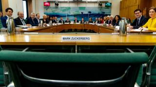 A meeting of the DCMS committee empty-chairing Mark Zuckerberg