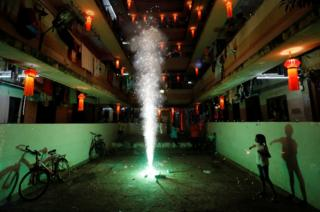 A girl plays with firecrackers.