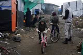 Child riding bike in the camp