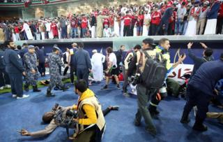 Fans are wounded after a glass barrier collapsed at the end of the Gulf Cup of Nations 2017 final football match between Oman and the UAE at the Sheikh Jaber al-Ahmad Stadium in Kuwait City, 5 January 2018