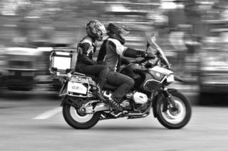 Two people on a bike