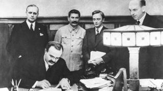 Vyacheslav Molotov signs the Non-aggression Pact between Germany and the USSR