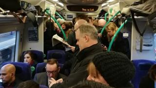 Passengers on Edinburgh to Glasgow train