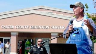 Joe Davis speaks to supporters of his wife Kim