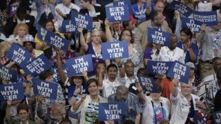 Delegates hold up signs in support of Hillary Clinton on Day 1 of the Democratic National Convention