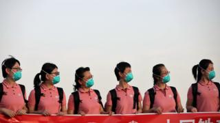 in_pictures Chinese medics in face masks at the main airport in Abuja, Nigeria - Wednesday 8 April 2020