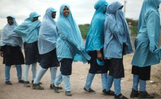 Schoolgirls in blue headscarves line up for lunch in Kajiado, Kenya - Wednesday 11 July 2018