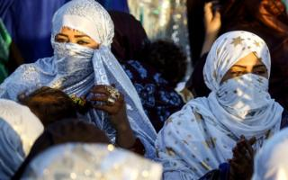 Tuareg women attend a traditional ceremony in the Libyan desert in the western Awal region near the borders with Tunisia and Algeria, about 600km (373 miles) south-west of the capital, Tripoli, on 29 March 2019