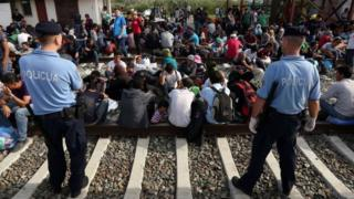 Migrants wait for train at Croatian border station of Tovarnik - 17 September