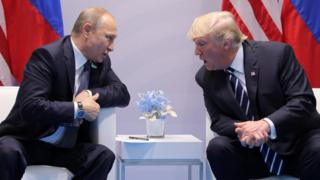 U.S. President Donald Trump speaks with Russian President Vladimir Putin during their bilateral meeting at the G20 summit in Hamburg on 7 July