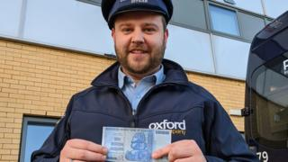 Oxford Bus Company staff with Zimbabwe note