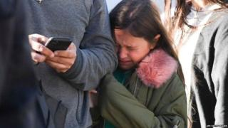 A young girl cries after the incident in New York.