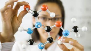 woman holding molecule model