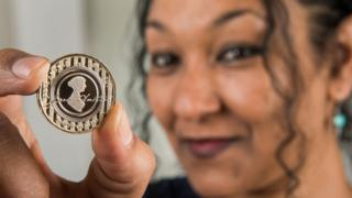 Designer Dominique Evans with the coin