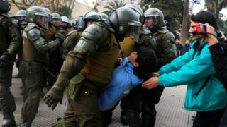 Police grabs student during demonstration in Santiago
