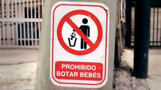 "A sign reading ""Dumping babies is forbidden """