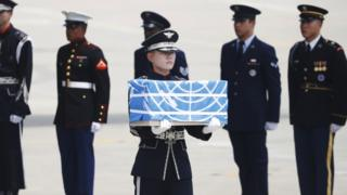 Soldier carries casket of remains in South Korea