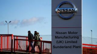 People walk into Nissan factory