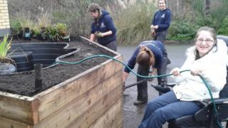 Staff and service-users at Swansea Vale Resource Centre creating a rain garden