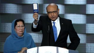 Khizr Khan, father of deceased Muslim US soldier Humayun Khan, holds up a booklet of the US Constitution as he delivers an impassioned speech at the Democratic National Convention in Philadelphia, Pennsylvania.