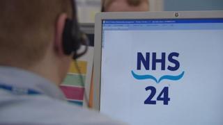 NHS 24 operator at screen