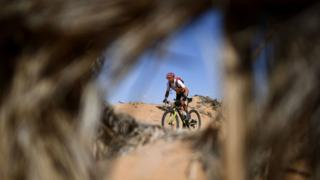 Competitors ride their bikes during Stage 6 of the 14th edition of Titan Desert 2019 mountain biking race between El-Jorf and Erfoud in Morocco on May 3, 2019.