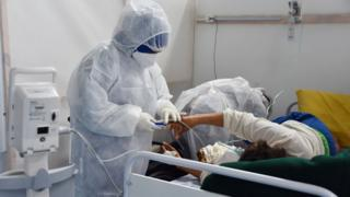 Health care worker treats a patient in Tunisia