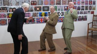 Gilbert and George danced with BBC presenter David Dimbleby during a documentary in 2009