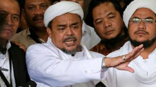 Leader of Islamic Defenders Front (FPI) Habib Rizieq (C) talks to reporters at a court after the blasphemy trial of Jakarta's incumbent governor Basuki Tjahaja Purnama, also known as Ahok, in Jakarta, Indonesia 28 February 2017.