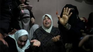 The mother of a Palestinian killed on the Gaza border on 30 March 2019, mourns at his funeral, 31 March 2019.