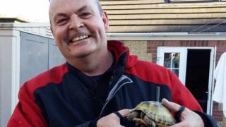 Fireman and rescued tortoise