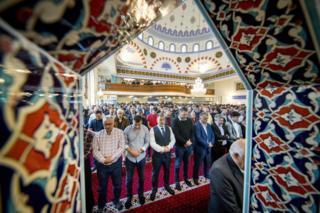 Muslims perform Eid al-Fitr prayer at the Mevlana mosque in Rotterdam on June 15, 2018