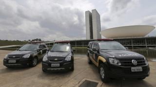 Senate police cars outside the Congress building in Brasilia, October 2016